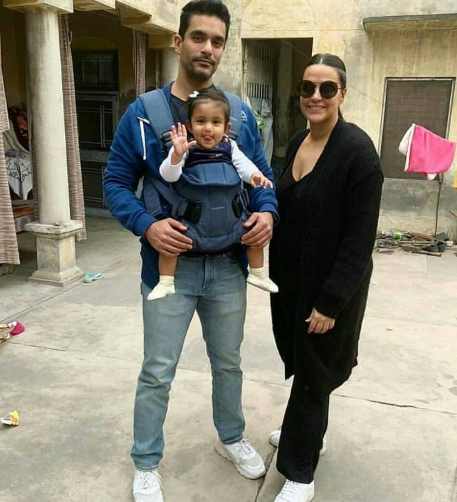 Neha Dhupia With Her Husband And Daughter