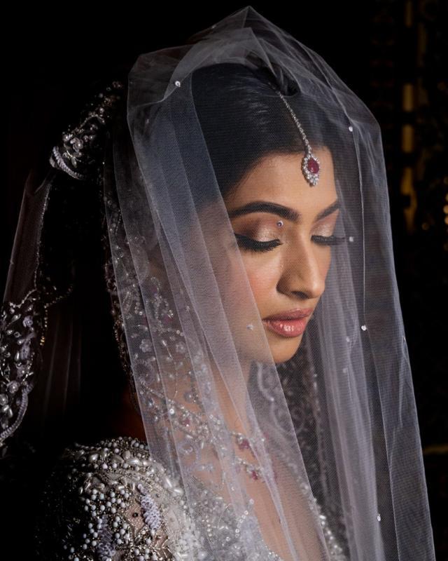 indian bride wearing eli saab gown