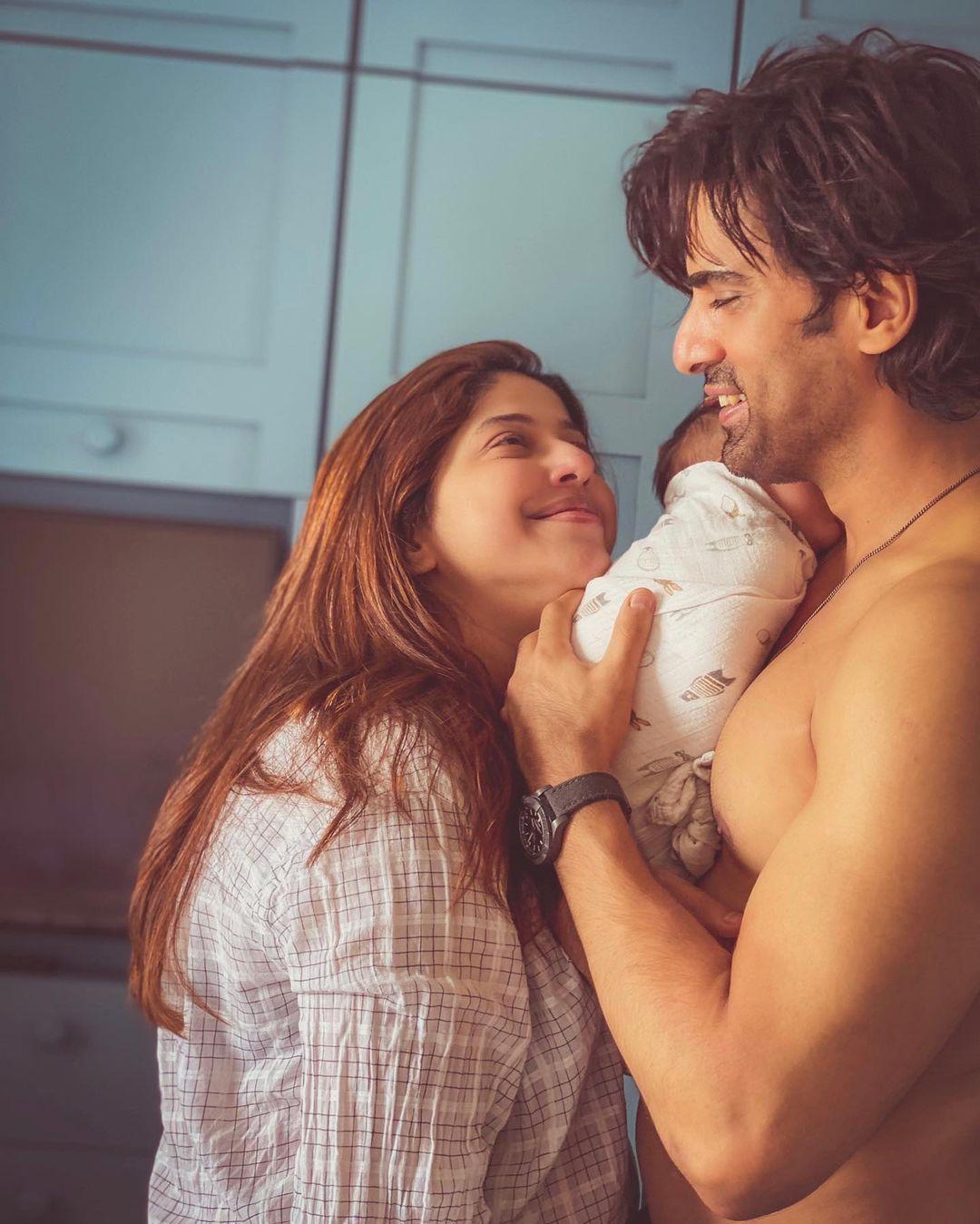 aditi malik with baby boy and husband